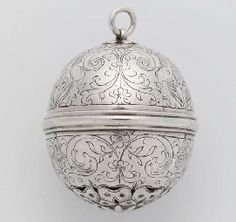 A RARE ENGLISH SILVER MUSK POMANDER, CIRCA 1600. Spherical, the moulded mid-rib with bayonet fitting, the lower hemisphere with finely pierced and engraved rose below a band of masks flanked by grotesque scrolls and flowers, the upper hemisphere engraved with birds on scrolls and flowers, the top engraved with a further rose.