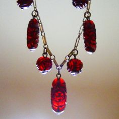 Antique carved Cherry Amber Fringe necklace, gold washed Sterling Silver chain.