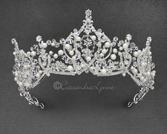 This regal wedding crown is designed with ivory pearls, crystal beads and clear rhinestones. Add this for a glamorous finishing touch to your wedding day! The decoration is 3 inches high and 14 inches long. Crystal Crown, Crystal Beads, Crystals, Bridal Tiara, Bridal Jewelry, Wedding Tiaras, Magical Jewelry, Esquivel, Ivory Pearl