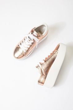 Cult Platform Sneaker | Statement metallic leather sneaks featuring a rubber platform.    * Lace-up   * Embossed logo on sole and heel cap   * Padded footbed    **Fit:** Runs true to size. If between sizes, size up.