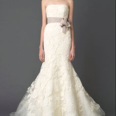 @samboehm11   Pretty lace mermaid wedding dress with sash
