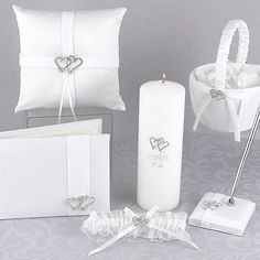 Add the luxury of white satin and double linked hearts rhinestones to your wedding day with the With All My Heart personalized white wedding accessory set.