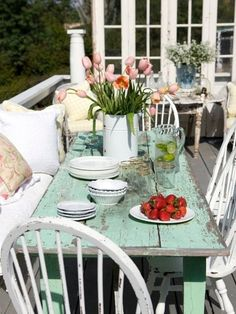 Patio Shabby Chic Cottage Decorating.. Ole the old rustic wood table and chairs.