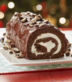 Ring in the New Year with a decadent chocolate and malted milk whipped cream roll. Once coated in chocolate ganache, this masterpiece is an impressive party dessert.