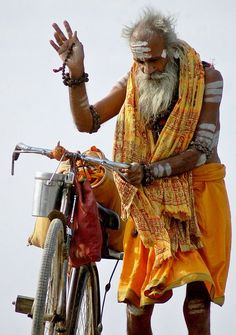 This photo from Rajasthan, West is titled 'Sadhu On Cycle'. We Are The World, People Around The World, Gente India, Namaste, Photo Souvenir, Amazing India, India People, Varanasi, Portraits