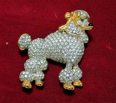 Vintage rhinestone poodle figural dog brooch Crystal rhinestones, with a black enamel nose, green eye, and bow Gold tone setting Unsigned 1 7/8 x 2 inches Good vintage condition, shows no wear, all stones are present I specialize in vintage figural animal jewelry, please visit my shop for more selections International buyers welcome, I can ship 3 jewelry items for 12$ USD, overcharges are refunded Priority shipping is optional 10417   Credit cards and Paypal accepted.
