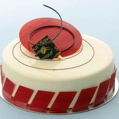 White chocolate, raspberry and passionfruit entremet from the Savour kitchen. Join a entremet class today www.savourschool.com.au #entremet #cake #gateaux #dessert #callebaut #choc