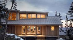 Maine Cabin by Whitten Architects - Elongated E-W axis for increased solar gains, highpoint of clear story oriented to north for soft diffused light, limited electrical lighting, and natural ventilation