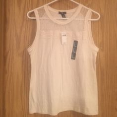 Sleeveless Lace and solid Gap Shirt NWT NWT Gap cream colored with light lace near too with a lace border across. Great with jeans or shorts. Just a tad to big for me. Size M GAP Tops Tank Tops