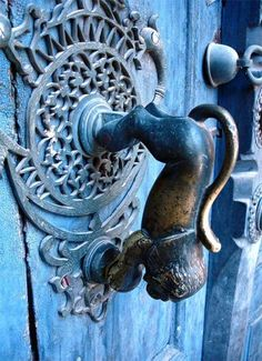 A photo of an intriguing door knob with classic Iranian national symbol of the lion taken in Kerman.