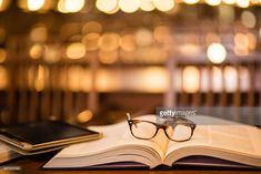 Stock Photo : Reading glasses and digital tablet on book