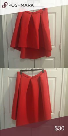 Red high low skirt This red high low full skirt made out of the scuba like material is to die for. It stuns where ever you wear it. There isn't any lining although the fabric is heavy. I've only worn this skirt once. Skirts High Low