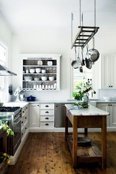 Open Country Kitchen - open wall cabinet and a repurposed ladder create storage in this bright, airy kitchen - via Willow Farm Homestead in Berry, New South Wales, UK