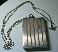Art Deco sterling chased engraved locket with old by lbjool, $100.00
