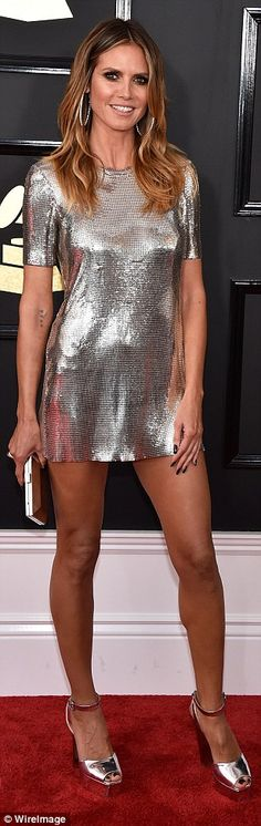Stunning: Heidi Klum looked fantastic in a silver Philip Plein mini dress and skyscraper h...
