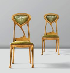 A PAIR OF PEARWOOD AND LEATHER CHAIRS BY HECTOR GUIMARD, CIRCA 1900-1910