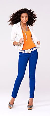 Color blocking with a colored denim, cute white jacket and wedges to boot.