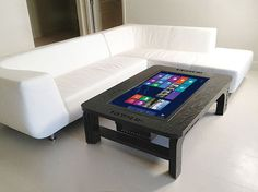 A coffee table that is also a 32 inch touchscreen