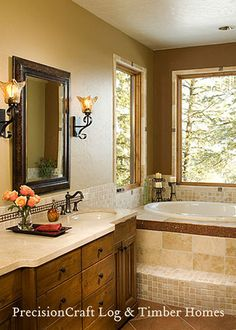 Bathroom : I like the earth tones used, the lighting and the not too cluttered decorating :)