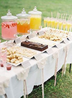 Pretty dessert table idea with 3 different colored drinks! Image via Happy Wedd