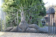 Wow - awesome tree gate - a fabulous entrance - Bex Simon handmade metals