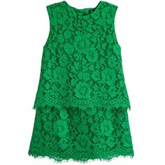 Girls emerald green lace top and skirt set by Dolce & Gabbana. This rich green colour has a beautiful depth. The lace overlay is in a floral design and the top is sleeveless, with a round neckline and raw-edged hem. It does up at the back with a concealed zip and is fully lined in stretchy satin trimmed with a delicate lace hem. The matching skirt is A-line shaped, with a back zip fastening