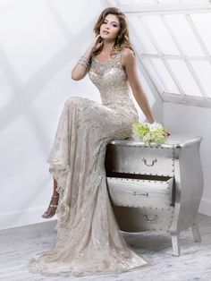 Sottero and Midgley - SONATA, This breathtaking tulle sheath with illusion neckline features mirrored jewels and sparkling Swarovski crystals atop beaded embroidery. Complete with zipper and crystal button back closure.