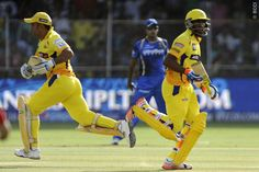 Mahendra Singh Dhoni captain of Chennai Super Kings and Dwayne Bravo of Chennai Super Kings run between the wickets during match 15 of the Pepsi IPL 2015 (Indian Premier League) between The Rajasthan Royals and The Chennai Superkings held at the Sardar Patel Stadium in Ahmedabad , India on the 19th April 2015.