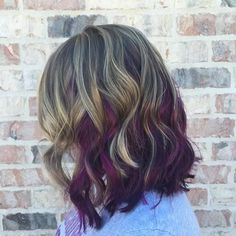 long brown bob with blonde and purple highlights