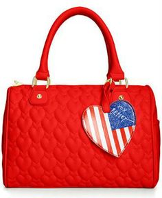 Stay a fashion beat ahead of the trend with this Quilted Hearts satchel from Betsey Johnson. Featuring a softly structured shape and plenty of pockets, it's certain to set any look aflutter. - Betsey