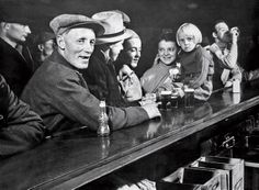 One of the photos from Margaret Bourke-White's cover story in the first issue of Life: Residents of Fort Peck gather at a saloon.  ~  LIFE magazine; November 23, 1936.