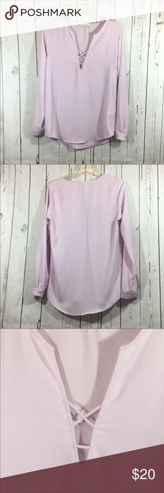 """Silence + Noise Lilac Purple Blouse Size Medium Silence + Noise Lilac Purple Spring 2018 Color Blouse Size Medium.  Long sleeves with button cuff. Strappy Front  cross v neck. Very good preowned condition. Length 26"""". Chest 19"""". Sleeve 25.5"""".  From my non smoking home. silence + noise Tops Blouses"""