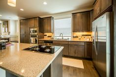 Huntwood Cabinets: Style- Savanah | Wood- Beech | Stain Color- Arctic Gray.......Mario & Sons | Quartz: LG | Color- Silver Lake