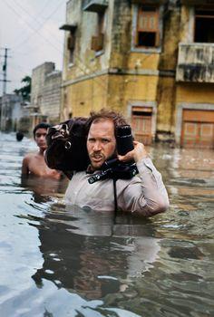 Steve McCurry in monsoon flood, Gujarat, India         -Steve McCurry-