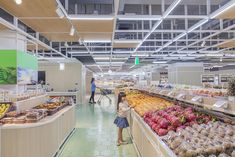 Completed in 2015 in Beijing, China. Images by Shannon Fagan . How does our design can function as a catalyst to merge people's shopping experience into the pleasure of a healthy lifestyle?  An organic market is...