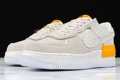 2020 Nike WMNS Air Force 1 Shadow Tan Orange Vast Grey Laser Orange-White CU3446-001  The Nike Air Force 1 Shadow is a womens exclusive release that has seen its fair share of color options. This offering sports a Beige-colored upper paired with Orange contrasting accents atop a White midsole with Black detailing includes a Swoosh lace dubrae. Other details includes a slightly higher midsole and core-outed outsole to make the shoe higher and more comfortable. Air Force 1, Nike Air Force, Beige Color, Basketball Shoes, Air Jordans, Nike Women, Core, Sneakers Nike, Pairs