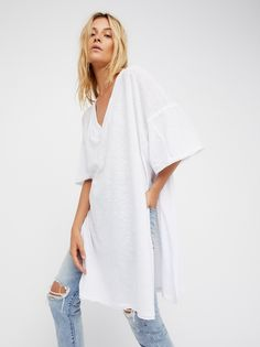 We The Free Solid City Slicker Tunic | Oversized, shapeless tunic featuring a wide V-neckline with dramatic side vents.    * Semi-sheer fabrication