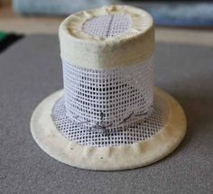 How to make a silk top hat for a riding habit. This tutorial is for a doll hat, but still applicable.