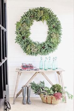 A Traditional Holiday With Linen And Boxwoods - Emily A. Clark. Large Green Wreath, Holiday Decor, Christmas Decor, Farmhouse Christmas, Rustic Christmas.