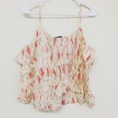 NWT Flowy Crop Top by Gap This gorgeous flowy crop top from the Gap is perfect for this coming spring and summer! It is brand new with tags and in perfect condition! It has adjustable straps and is a size large! Check it out! GAP Tops Crop Tops