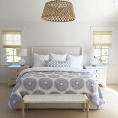 Coastal Bedroom with blue and white bedding by John Robshaw. Woven chandelier is by Made Goods. #Bedroom #CoastalBedroom #MadeGoods #Lighting #WovenChandelier #Wovenlighting Rita Chan Interiors.