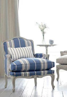 striped blue chair with puffy down cushion.