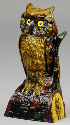 OWL TURNS HEAD MECHANICAL BANK, BROWN J & E Stevens Co., designed by James H. Bowen, patented 9/28/1880. The above bank has glass eyes and is nicely ornamented in natural colors. Place a coin on the top of the branch, and press the thumb-piece at the back, when the head of the owl turns, the coin is deposited below, after which the head moves back to its former position.