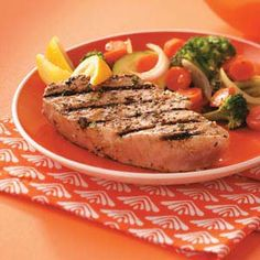 """Grilled Tuna Steaks for Two Recipe -""""After enjoying yellowfin tuna at a restaurant in southwest Florida, I came up with this recipe so I could enjoy the flavor of my favorite fish at home."""" —Jan Huntington, Painesville, Ohio"""