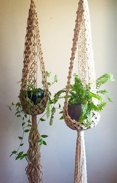 Lovely Bohemian Style Macramé Plant Hangers Stella in Jute or White Cotton Rope! Also work with Mid Century Modern and Jungalow Style Decor. Two lengths available. Pictured are the 53 in the Jute and the 60 in the White Rope. These are Custom Made so please allow a few inches variation (+ or -). This Listing is for ONE of the 4 different variations on this design. Jute Stella 53 Jute Stella 60 White Kali 53 White Kali 60 The pots and plants are not included but are shown for perspective. ...
