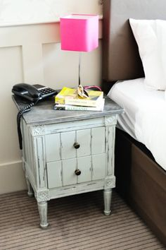 The Bourbon Vintage Bedside Table in use at our customer Carla's home. MADE.COM/Unboxed