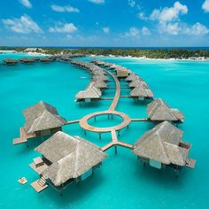 four seasons bora bora, tahiti. by tracy gallagher, via a house in the hills.