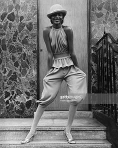 Fashion model Hazel wearing coffee-coloured knickerbockers and a peplum bib top designed by John Bates for Jean Varon.