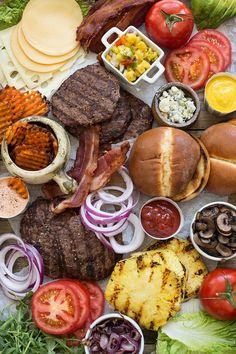 A Gourmet Burger Board is a fun way to present a classic barbecue. Pile grilled burgers on a board, along with every sauce and topping you can think of, for the ultimate make-your-own burger buffet! Charcuterie Recipes, Charcuterie And Cheese Board, Burger Bar Party, Grill Party, Make Your Own Burger, Seven Layer Dip, Party Food Platters, Burger Toppings, Gourmet Burgers