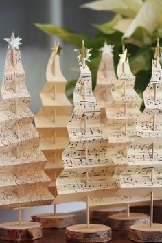 weihnachtsdeko diy ideen altes notenpapier weihnachtsbaum selber basteln - beautiful handmade / homemade Christmas decorations made in the shape of Christmas trees using music paper Noel Christmas, Winter Christmas, Paper Christmas Trees, Xmas Trees, Diy Christmas Table Decorations, Vintage Christmas Trees, Christmas 2019, Creative Christmas Trees, Christmas Tables